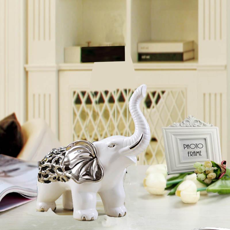陶瓷工艺品 时尚家居陶瓷工艺品电镀情侣大象批发 阿里巴巴图片